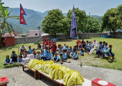 Kids at the Pame Basic school waiting for their yellow bag containing their new uniform