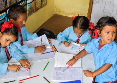 Astam nursery to class 2 drawing with their new colour pencils