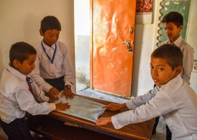 A new cloth, so a bit of a fight who would get to wipe the desks.  These kids resolved it by doing it together