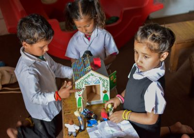 Dreaming and concentrating while playing with one of their favourite things, this house with all the little people