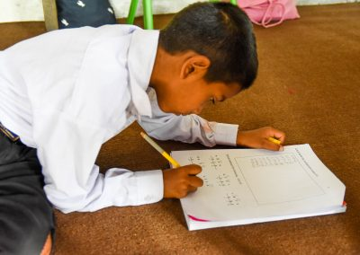 Ashish concentrating on his maths exam