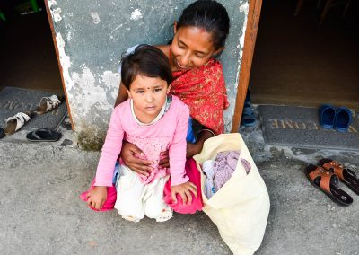 This mother got some new clothes for her kids, thank you you who gave us clothes