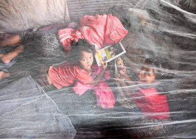 The big sister was so sick she had to sleep outside, her temperature was so high, but at least under a mosquito net