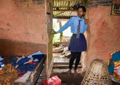 One of the older girls, and the chickens under the basket who also live in the room